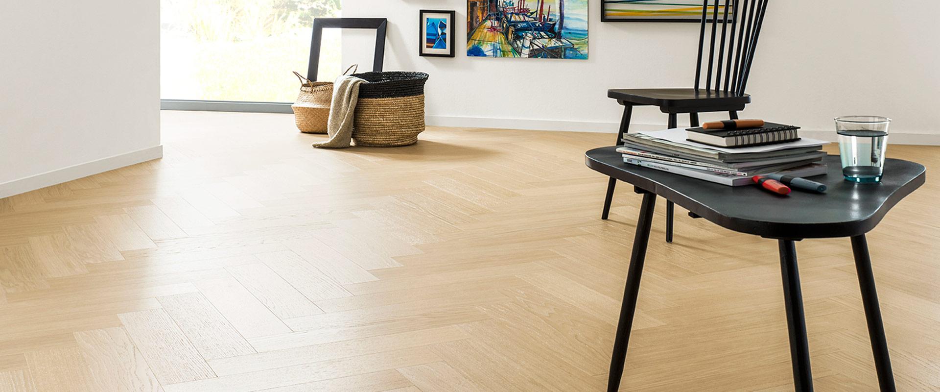 Lichte houten vloer pvc visgraat Vloerenland